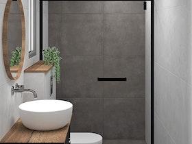 מקלחת משופצת עם כיור לבן ומראה תלוייה