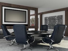 סלון עבודה עם כסאות עור שחורות וטלויזיה לתצוגה